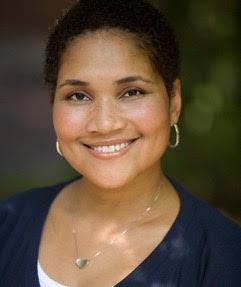 black woman smiles confidently